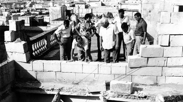 Laying bricks in the rebuilding of Malta.
