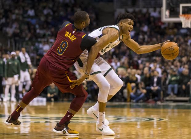Cleveland Cavaliers guard Dwyane Wade (9) defends Milwaukee Bucks forward Giannis Antetokounmpo during the fourth quarter at BMO Harris Bradley Center. Photo: Jeff Hanisch-USA TODAY Sports
