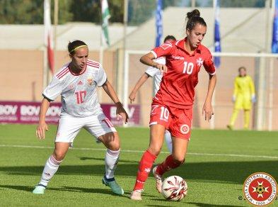 Martina Borg (right) of Malta protects the ball from her Hungarian marker during the game. Photo: Malta FA