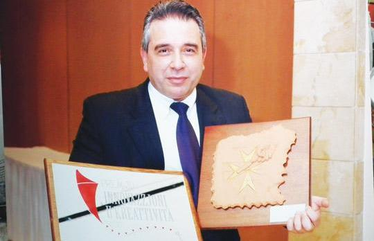 Joe Galea, owner of Heritage Homes and Artistorika holding the Ġieħ l-Artiġġjanat Malti 2010 award and the Intellectual Property Award 2010 for creativity.