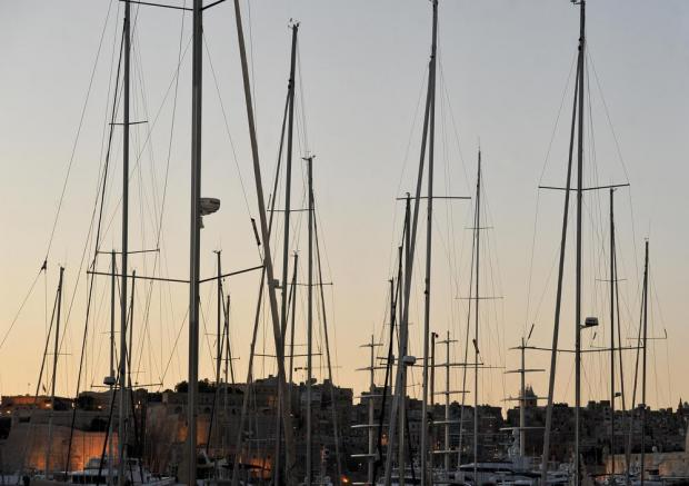 Sailing boat masts are semi-silhouetted against the evening sky in Vittoriosa on March 30. Photo: Chris Sant Fournier
