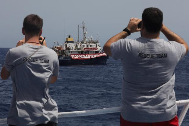 Lifeguards from the Spanish NGO Proactiva Open Arms aboard former fishing trawler Golf Azzurro watch the C Star in the Western Mediterranean Sea August 15, 2017. Photo: Reuters