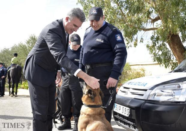 Home Affairs Minister Carmelo Abela pets a police dog during an open day held at the Civil Protection headquarters in Xemxija on February 13. Photo: Mark Zammit Cordina
