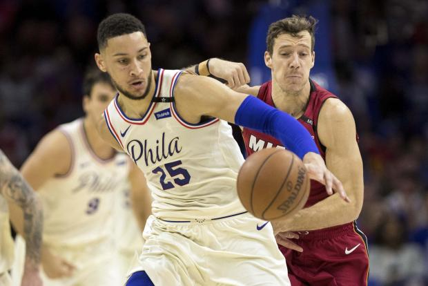 Philadelphia 76ers guard Ben Simmons (25) dribbles past Miami Heat guard Goran Dragic (7) in game five of the first round of the 2018 NBA Playoffs at Wells Fargo Center. Photo Credit: Bill Streicher-USA TODAY Sports