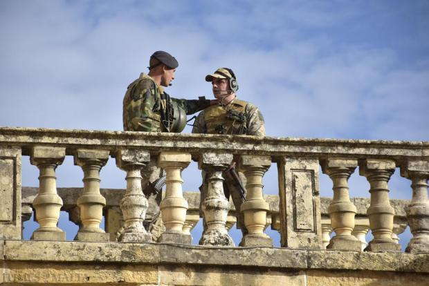Two Armed Forces of Malta soldiers speak while on guard at San Anton Palace in Attard shortly before Queen Elizabeth arrived on the first day of her State Visit on November 26. Photo: Mark Zammit Cordina