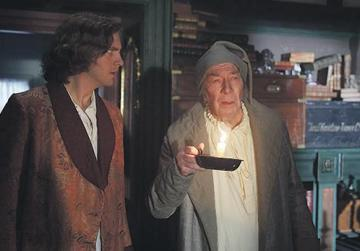 Dan Stevens (left) dreams up Christopher Plummer's character Scrooge in The Man Who Invented Christmas.