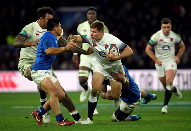 England's Piers Francis charges forward against Samoa.