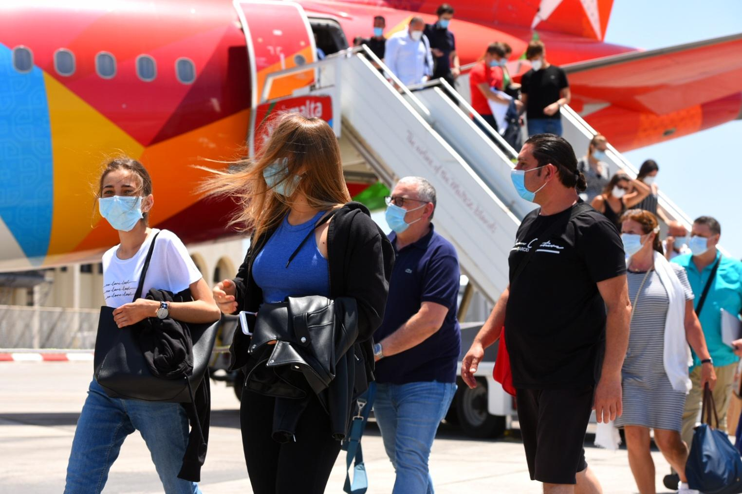 Passengers on the first Air Malta commercial flight, from Rome, on Wednesday. Photo: Chris Sant Fournier