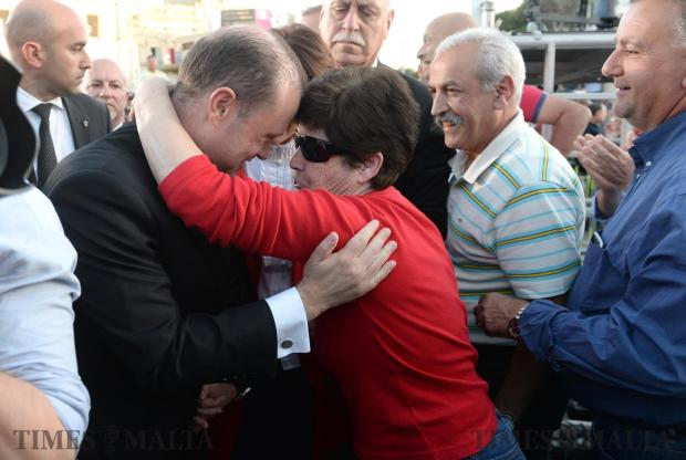 Prime Minister Joseph Muscat is greeted by supporters at a meeting in Ta'Xbiex on May 3. Photo: Matthew Mirabelli