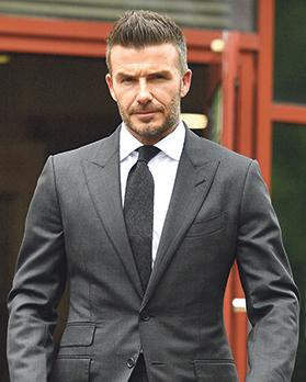 David Beckham leaves Bromley Magistrates Court after being disqualified from driving for six months for driving while using a mobile phone. Photo: Daniel Leal-Olivas/AFP