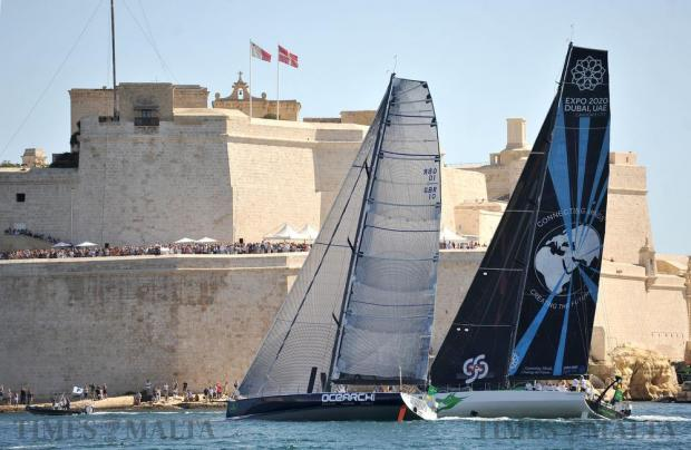 Two sailboats sail neck and neck in front of Fort St Angelo in Grand Harbour shortly after the start of the Rolex Middle Sea Race on October 22. Photo: Chris Sant Fournier