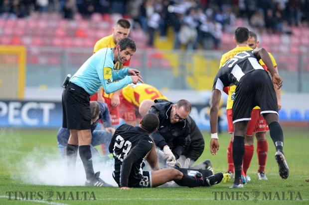 Referee Mario Apap talks to Hibernians striker Jorginho as he receives medical attention against Birkirkara at the National Stadium in Ta' Qali on January 29. Photo: Matthew Mirabelli