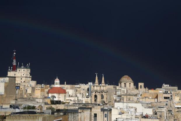 A faint rainbow is seen over Valletta after a heavy rainstorm on January 26. Photo: Darrin Zammit Lupi