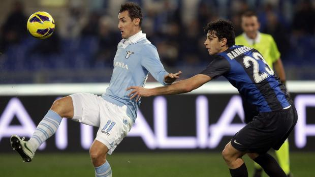 Lazio's Miroslav Klose (L) is challenged by Andrea Ranocchia of Inter.