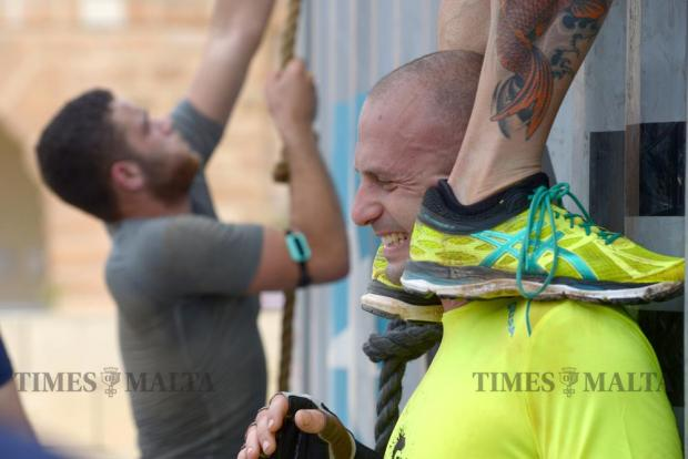A participant is helped over the last obstacle whilst taking part in The Grid obstacle course race in Pembroke on May 29. The race, the first of its kind in Malta, covered 15km and included over 30 obstacles. Photo: Matthew Mirabelli