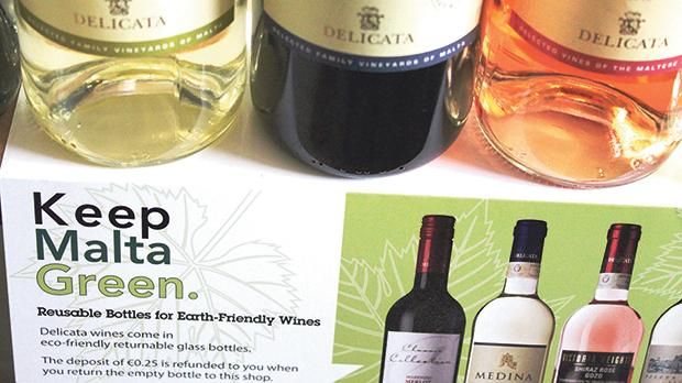 Delicata's shelf talkers encourage customers to return their empty wine bottles.