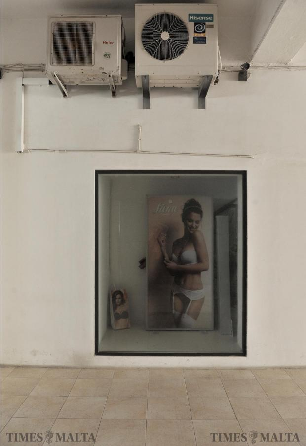 The shop window of a shop that has shut down at the City Gate shopping arcade in Valletta on May 2. Photo: Chris Sant Fournier