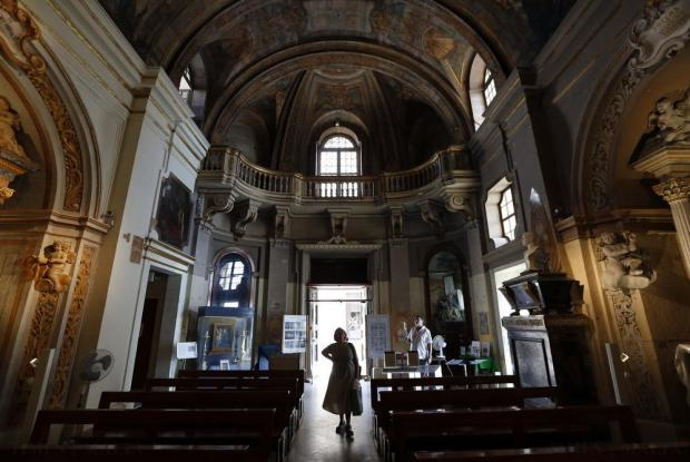 A tourist visits the Church of Our Lady of Victory in Valletta on August 25. Photo: Darrin Zammit Lupi