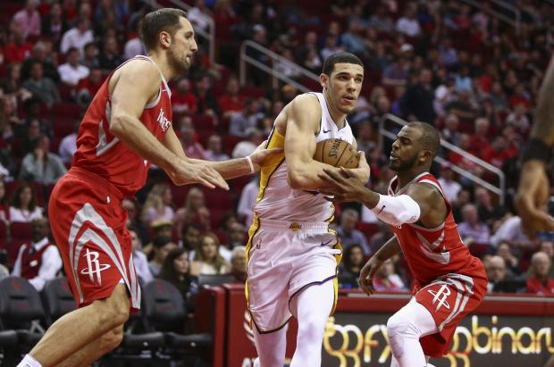 Los Angeles Lakers guard Lonzo Ball (2) drives with the ball as Houston Rockets forward Ryan Anderson (33) and guard Chris Paul (3) defend during the third quarter at Toyota Center. Photo: Troy Taormina-USA TODAY Sports