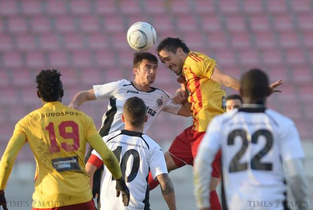 Hibernians' Bjorn Kristensen (centre left), and Birkirkara's Nikola Vukanac (centre right) challenge for a high ball during their Premier League match at the National Stadium in Ta'Qali on January 24. Photo: Matthew Mirabelli