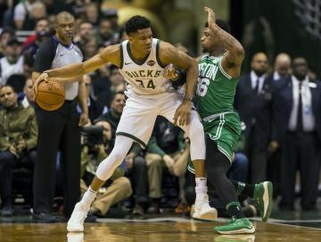 Milwaukee Bucks forward Giannis Antetokounmpo (34) works for a shot against Boston Celtics guard Marcus Smart (36) during the second quarter in game six of the first round of the 2018 NBA Playoffs at BMO Harris Bradley Center. Photo Credit: Jeff Hanisch-USA TODAY Sports