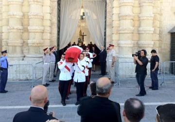 The coffin is carried out of the Palace. Picture: Jason Borg.