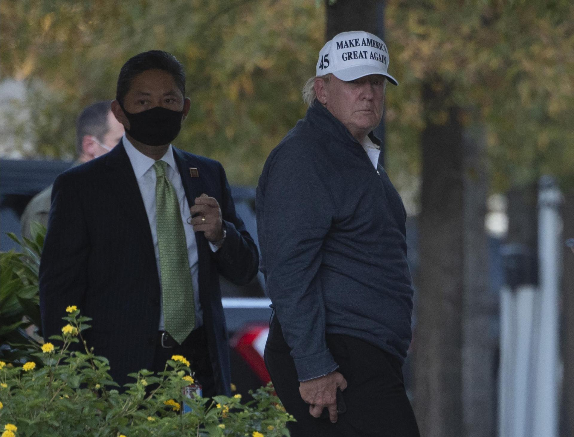 Donald Trump returns to the White House from a round of golf following Biden's declaration of victory. Photo: AFP