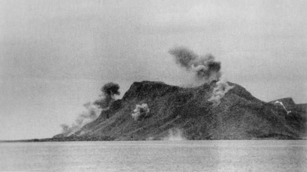 Mount Scumbarda on the island of Leros under aerial bombardment.