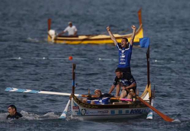 Oarsmen from the town of Cospicua celebrate winning the Freedom Day Regatta in Valletta's Grand Harbour on March 31. Photo: Darrin Zammit Lupi