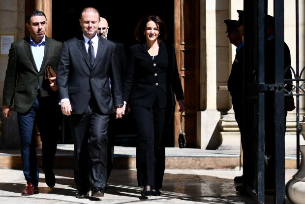Joseph Muscat and his wife Michelle walking out of court on April 22.