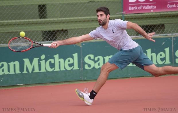 Matthew Asciak hits a shot during the men's Masters Tennis Tournament at Marsa on December 27. Photo: Matthew Mirabelli