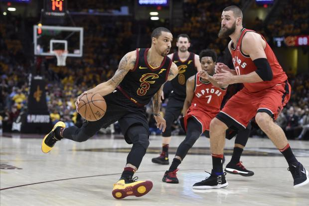 Cleveland Cavaliers guard George Hill (3) drives against Toronto Raptors center Jonas Valanciunas (17) in the third quarter in game four of the second round of the 2018 NBA Playoffs at Quicken Loans Arena. Photo Credit: David Richard-USA TODAY Sports