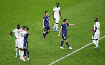 Japan and Senegal players react after the match.