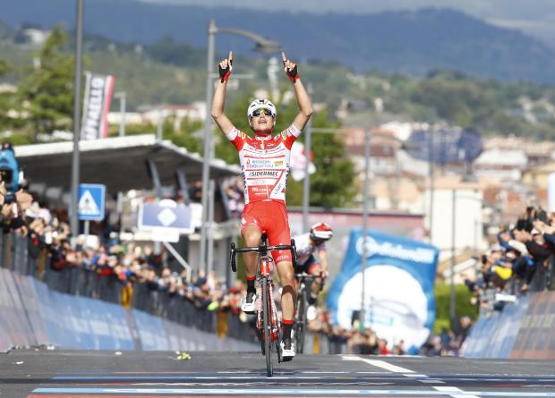 Team Androni rider Italy's Fausto Masnada celebrates after winning the stage six.