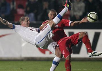 Czech Republic's David Limbersky (L) and Malta's Shaun Bajada fight for the ball during the 2014 World Cup qualifying soccer match in Plzen. Photo: David W Cerny, Reuters
