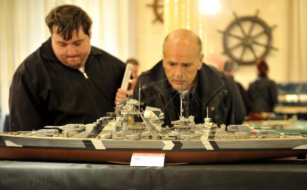 A couple of scale model enthusiasts scrutinize a model of the infamous German battleship KMS Bismark at the Maritime Museum in Vittoriosa on February 10. The Bismarck forms part of the annual exhibition organised by the Society for Scale Modellers. Photo: Chris Sant Fournier