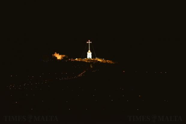 Laferla cross is lit up and oil lanterns surround the hill during Maundy Thursday on March 29. Photo: Mark Zammit Cordina