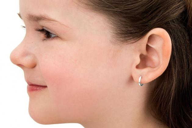 Earring U-turn: studs at school are fine, says Education Minister
