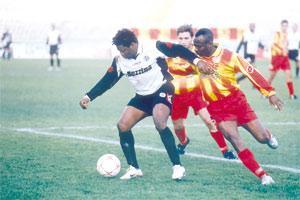 Hibernians` Ndubisi Chukunyere (left) holds off Birkirkara`s Precious Monye during the second round match.