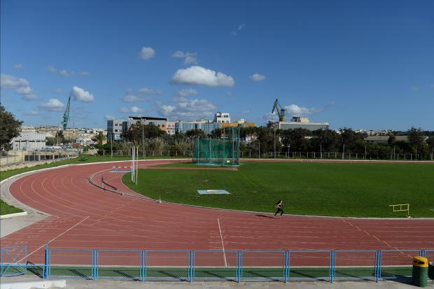 A girl runs around the track in Marsa on March 5. Photo: Matthew Mirabelli
