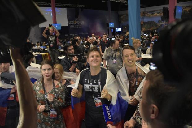 Russian journalists at the Eurovision press centre cheer on their country's Eurovision entry during the semi-final in Stockholm on May 10. Photo: Mark Zammit Cordina