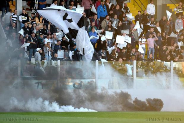 Black and white smoke is let off at the beginning of the Premier League match between Tarxien Rainbows and Hibernians at the Hibs Stadium in Paola on December 12. Photo: Matthew Mirabelli