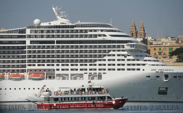 A harbour cruise boat makes its way past a large cruise liner in the Grand Harbour on October 4. Photo: Matthew Mirabelli
