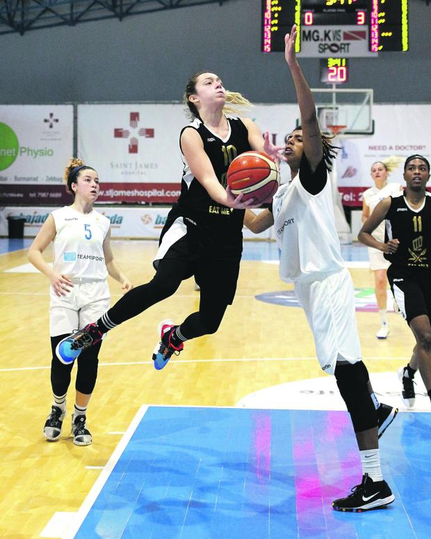 Hibs' Sophie Abela (left) goes for the basket despite the challenge of Giocelis Reynoso. Photo: Wally Galea