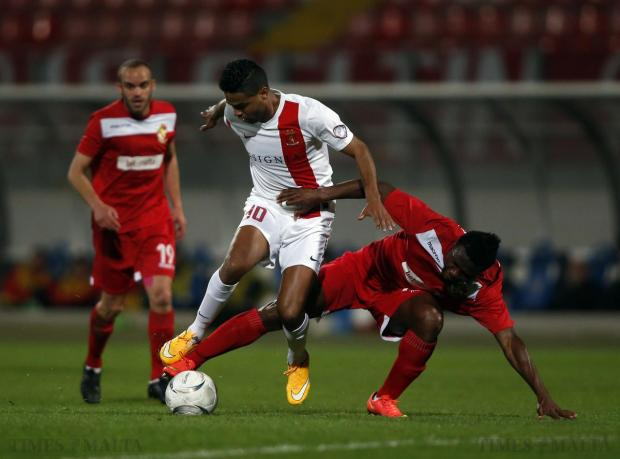 Valletta's Abdelkarim Nafti (centre) is challenged by Naxxar Lions' Albert Bruce during their Premier League football match at the National Stadium in Ta' Qali on April 6. Photo: Darrin Zammit Lupi