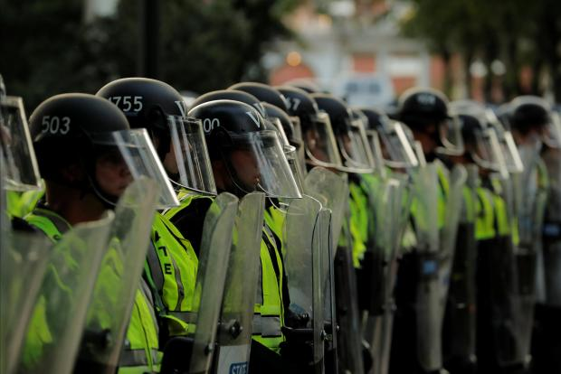 Police in riot gear line up. Photo: Reuters