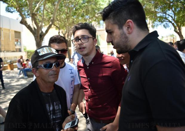 Zaren Bonnici from the Tal-Ajkla political party talks to student's moments before a debate starts at the University of Malta between the main political leaders on May 17. Photo: Mark Zammit Cordina