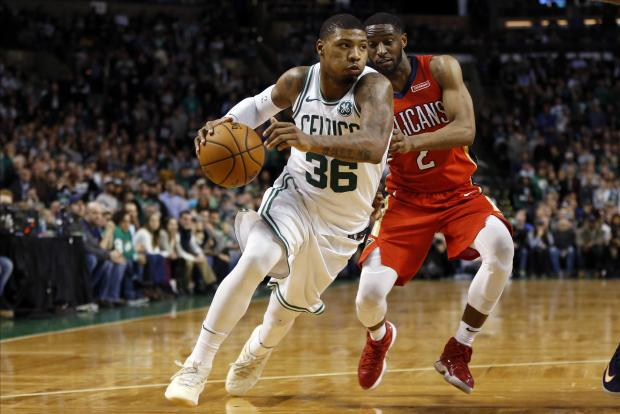 Boston Celtics guard Marcus Smart (36) is guarded by New Orleans Pelicans guard Ian Clark (2) during overtime at TD Garden. Photo: Greg M. Cooper-USA TODAY Sports