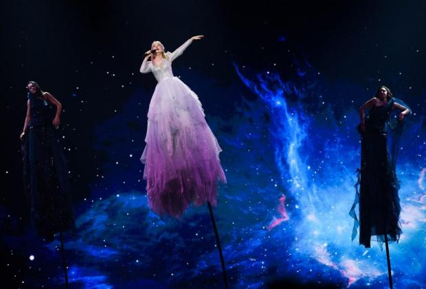 Australia's Kate Miller-Heidke soars in the air... and the in odds.