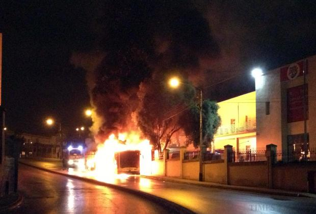 A bendy bus is engulfed in flames soon after catching fire near the Maltapost head office in Qormi in the early hours of August 25. Photo: Jason Borg